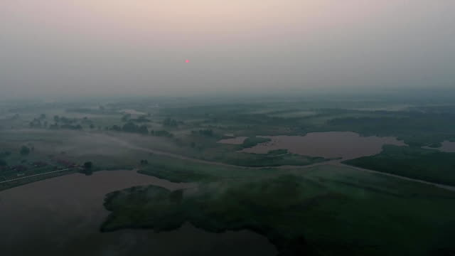 Aerial View. Panoramic summer morning landscape. The picturesque landscape with river, trees and field with Incredible sun. Morning Fog. Aerial View. Panoramic summer morning landscape. The picturesque landscape with river, trees and field with Incredible sun. Morning Fog. kazakhstan stock videos & royalty-free footage