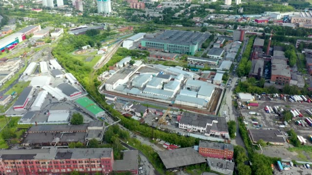 Aerial view park production plant. Manufacturing area in industrial city drone view. Territory industrial factory sky view. Aerial industrial cityscape.