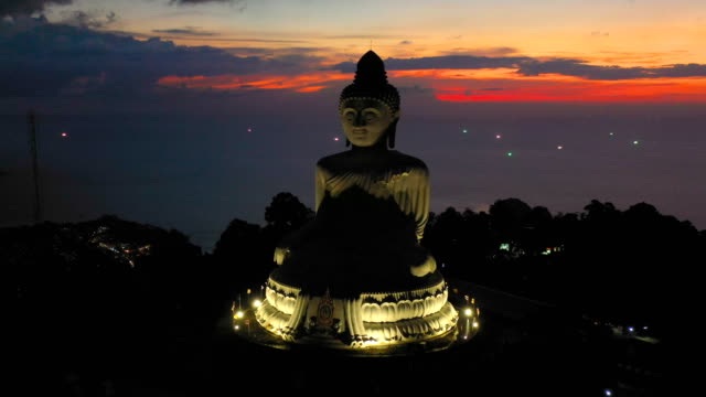 aerial view Phuket big Buddha in twilight aerial view Phuket big Buddha in twilight.Phuket Big Buddha is one of the island most important and revered landmark on Phuket island location is on the high mountain can see view around Phuket island buddha stock videos & royalty-free footage