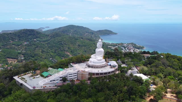 aerial view phuket big buddha is one of the island most important and revered landmarks on the island. - пхукет стоковые видео и кадры b-roll