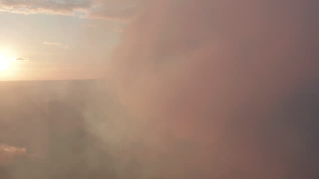 Aerial view. Pipes Throwing Smoke in the Sky at the sunset