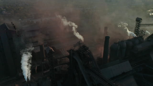 Video Aerial view. Pipes Throwing Smoke in the Sky. Environmental pollution concept danger to planet earth