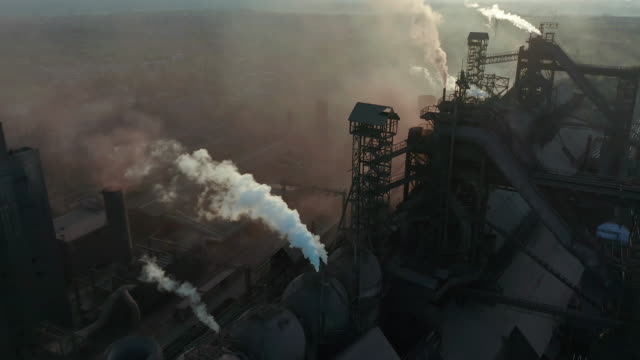 aerial view. pipes throwing smoke in the sky. environmental pollution concept danger to planet earth - смог над городом стоковые видео и кадры b-roll
