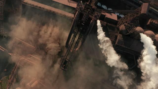 aerial view. pipes throwing smoke in the sky - ущерб окружающей среде стоковые видео и кадры b-roll