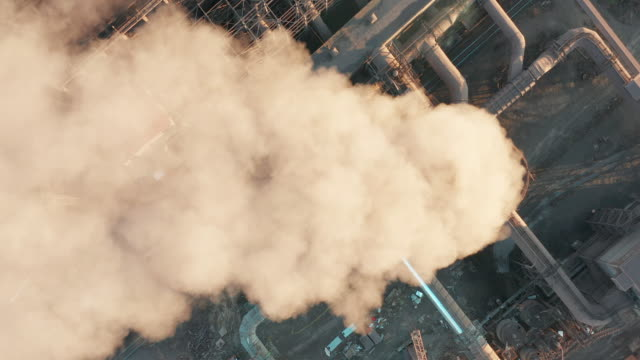 Aerial view. Pipes Throwing Smoke in the Sky