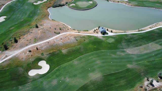 Aerial View Point of A Par 5 Next to a Pond