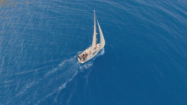 Aerial view. Sailing yachts with white sails in the open Sea