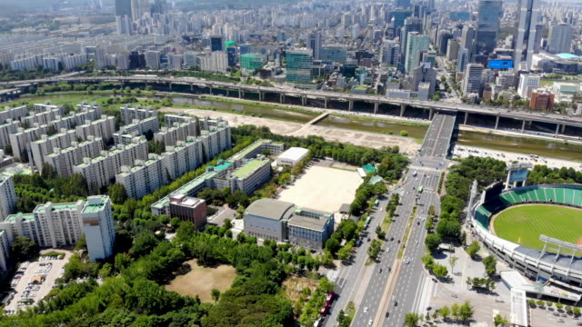 Aerial view Seoul Olympic Park, South Korea. Baseball stadium built for the 1988 Summer Olympics and the 10th Asian Games in 1986.Baseball Stadium with city. Seoul, South Korea international match stock videos & royalty-free footage
