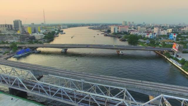 aerial view shot of bridge construction site - fiume chao phraya video stock e b–roll