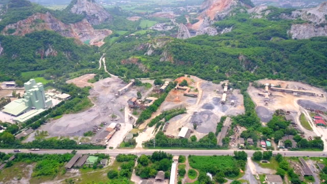 Aerial view shot of Mine and heavy equipment limestone crusher and truck video