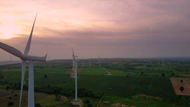 Aerial view shot of Wind turbines at evening- renewable energy video