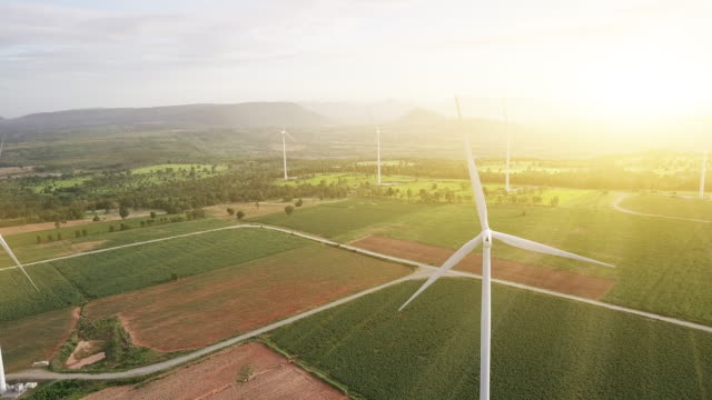 Aerial view shot of Wind Turbines at morning