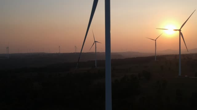 Aerial view shot of Wind turbines at sunset video