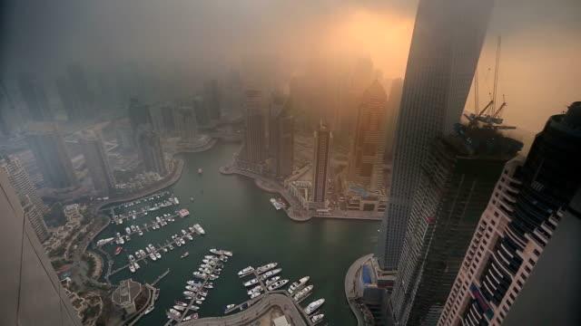 aerial view skyscraper foggy weather Dubai Marina aerial view skyscraper foggy weather Dubai Marina at United Arab Emirates UAE heat haze stock videos & royalty-free footage
