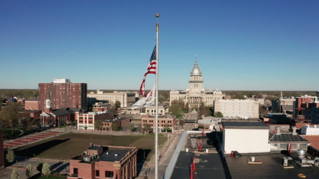 Aerial View Static Over Buildings and Downtown Springfield Illinois US Flag