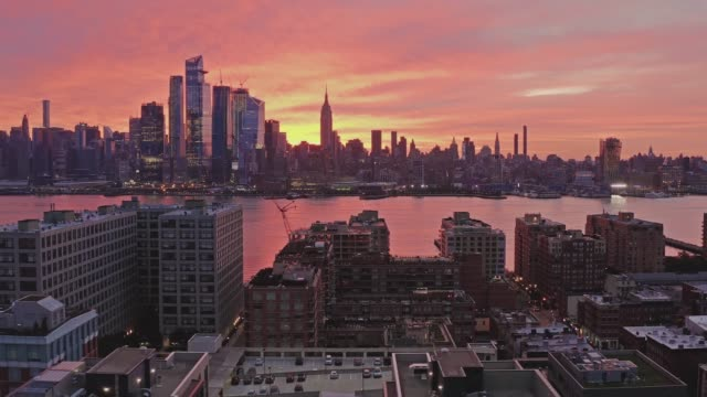 Aerial View Sunrise at Downtown New York City and Hoboken 4k Drone Shot. Modern buildings in New Jersey and Manhattan view at morning new york city skyline stock videos & royalty-free footage