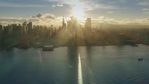 Aerial View Sunrise at New York City and sunflares 4k Midtown Sunrise series Drone Shot. Modern building on Hudson river and Manhattan view at morning morning stock videos & royalty-free footage