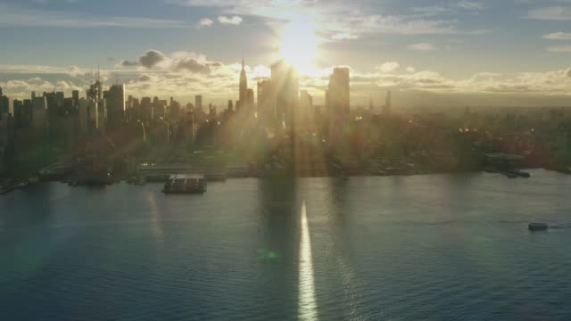 aerial view sunrise at new york city and sunflares 4k midtown sunrise series - new york architecture stock videos & royalty-free footage