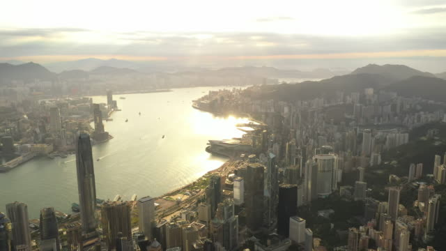 Aerial View Sunrise of the Hong Kong City Skyline with twilight and golden sky 4K stock video.