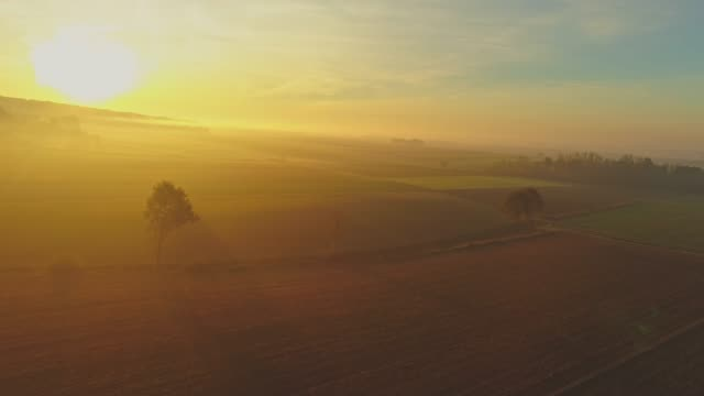 WS Aerial view sunrise shining over tranquil,rural landscape,Slovenia video