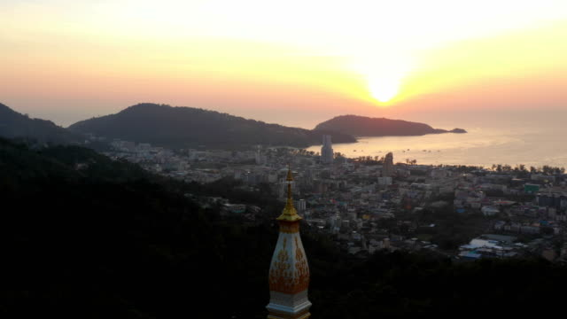 aerial view sunset at pagoda on doi thepnimit patong phuket - пхукет стоковые видео и кадры b-roll
