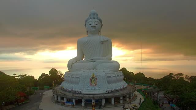 aerial view sunset at phuket big buddha - buddha video stock e b–roll