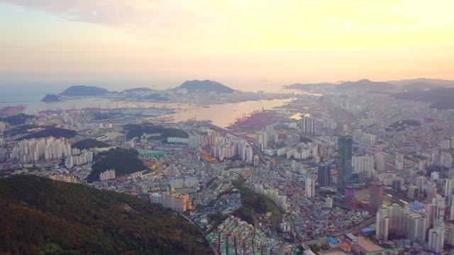 vídeos de stock e filmes b-roll de aerial view sunset of busan city cityscape south korea - seul