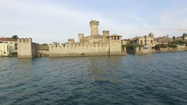 Aerial view. The Scaliger Castle in Sirmione. Lake Garda, Italy. 4K.