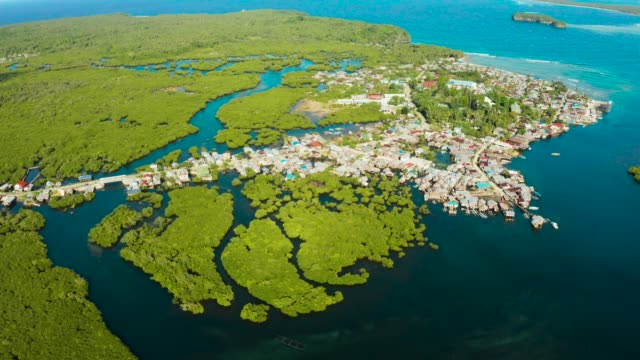 Aerial view The town is in mangroves. Siargao,Philippines Village near mangroves in the bay of the ocean, top view. Siargao island, Philippines. wetland stock videos & royalty-free footage