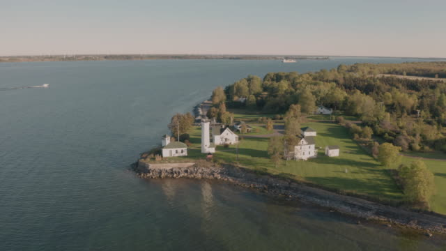 aerial view tibbetts point lighthouse shores of lake ontario in new york state - penisola video stock e b–roll