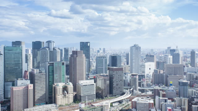 Aerial view time lapse of Osaka cityscape with clouds move video