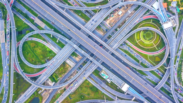 Aerial view Time lapse of the expressway, motorway and highway in the detail of circus intersection