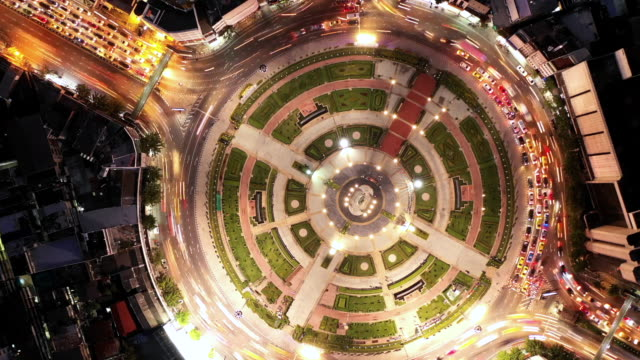 Aerial view time lapse road roundabout with car lots, Aerial view road traffic in city at night. Aerial view road roundabout with car lots, Aerial view road traffic in city at night, Time lapse. large stock videos & royalty-free footage