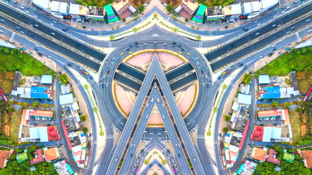 aerial view time lapse traffic in expressway, motorway and highway in the detail of circus intersection - singapore architecture stock videos & royalty-free footage