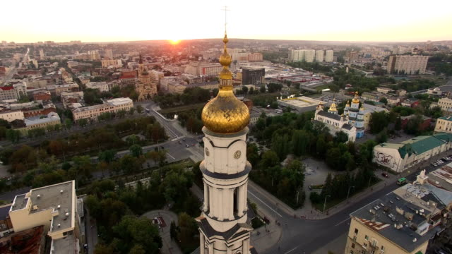 aerial view to holy dormition cathedral in kharkiv at sunset - ferragosto video stock e b–roll