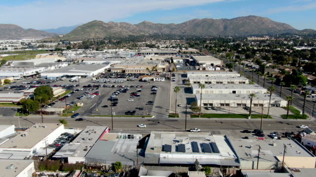 Aerial view to industrial zone and company storage warehouse in RIverside Aerial view to industrial zone and company storage warehouse in RIverside, California, USA warehouse aerial stock videos & royalty-free footage