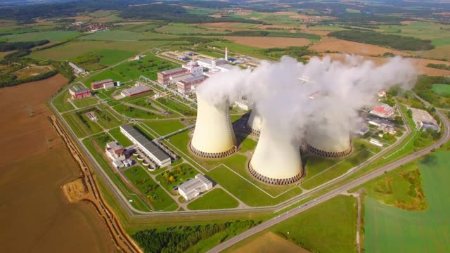 aerial view to nuclear power plant. atomic power stations are very important sources of electricity with low carbon footprint. - energia sostenibile video stock e b–roll