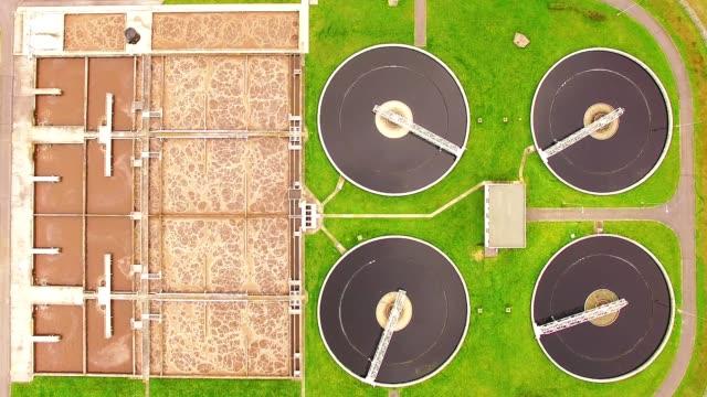 aerial view to sewage treatment plant. grey water recycling. waste management theme. - биомасса возобновляемая энергия стоковые видео и кадры b-roll