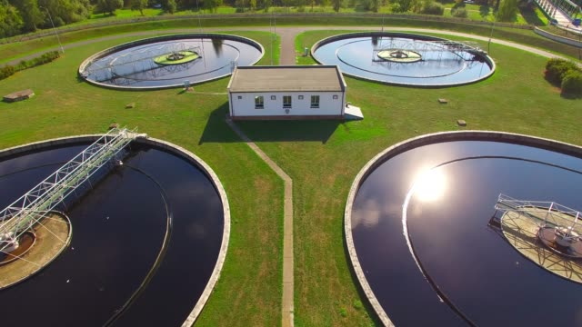 Aerial view to sewage treatment plant. Grey water recycling. Waste management theme. Public sewage treatment plant in Czech Republic. Waste management from above. European environment and ecology. biomass renewable energy source stock videos & royalty-free footage