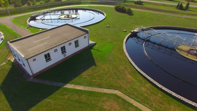 Aerial view to sewage treatment plant. Grey water recycling. Waste management theme.