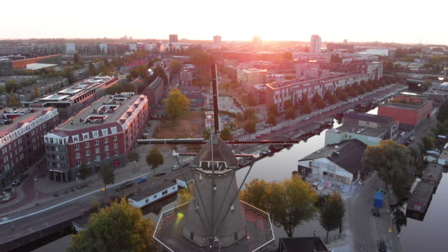 aerial view to windmill in amsterdam - amsterdam video stock e b–roll