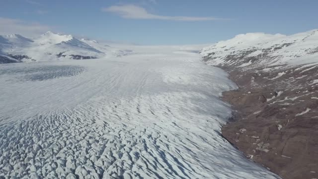Aerial view: Top View Glacier Ice Flow Texture Vibrant Blue. Climate Change and Global Warming. Arctic nature ice landscape in Unesco World Heritage Site. Beautiful background concept Iceberg european alps stock videos & royalty-free footage