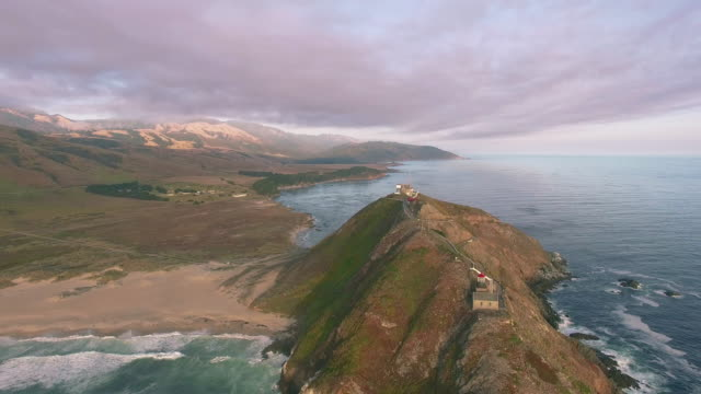 4K aerial view toward island big sur lighthouse video