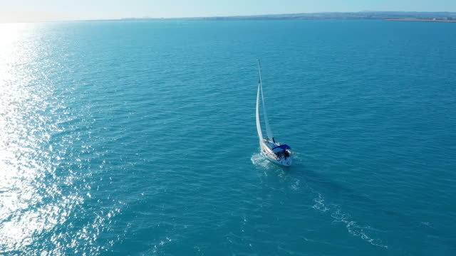 Aerial view. Traditional yacht sailing across sea