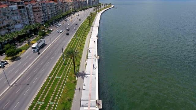 stockvideo's en b-roll-footage met luchtfoto verkeer kustweg van de lijn op een heldere zonnige dag. luchtfoto boven de kust snelweg. - athens