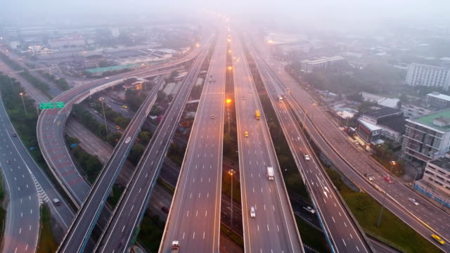 Aerial view traffic on highway with mist in morning. Aerial view traffic on highway with mist in morning. jakarta stock videos & royalty-free footage