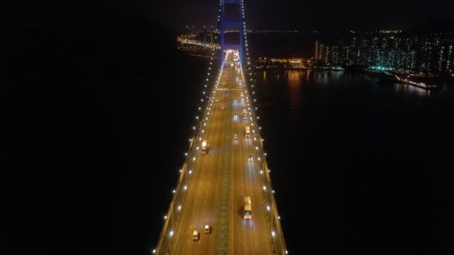 Aerial view Tsing Ma Bridge transportation 4k Real time aerial view of Tsing Ma Bridge at night time, Famous place and landmark in Hong Kong, Long suspension bridge and beautiful architecture suspension bridge stock videos & royalty-free footage