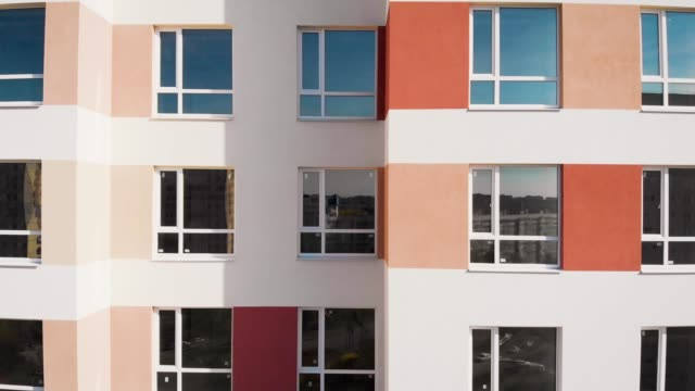 aerial view. Typical panel development. Budget apartments in multi-storey buildings with multi-colored facades