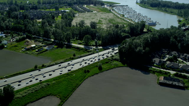 Aerial view vehicles crossing road bridge, Vancouver Aerial view motor vehicles crossing road bridge Fraser River, Annacis Highway, Annacis Island, Vancouver, British Columbia, Canada RED EPIC fraser river stock videos & royalty-free footage