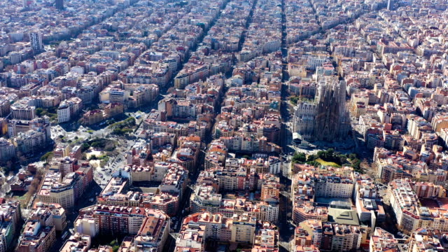 Aerial view video footage of residence districts in european city. Eixample district. Barcelona, Spain. Sagrada familia church Aerial view video footage of residence districts in european city. Eixample district. Barcelona, Spain. Sagrada familia church. top view general view stock videos & royalty-free footage